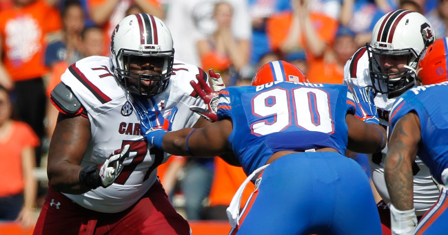 Nov 15, 2014; Gainesville, FL, USA; South Carolina Gamecocks offensive tackle Brandon Shell (71) blocks Florida Gators defensive lineman Jonathan Bullard (90) during the second quarter at Ben Hill Griffin Stadium. Mandatory Credit: Kim Klement-USA TODAY Sports